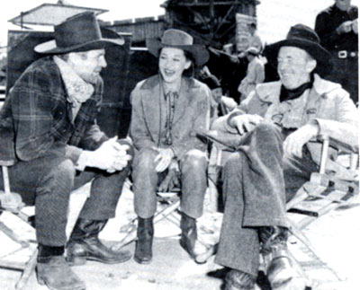 "Jim Davis, Adrian Booth and Walter Brennan on the set of Republic's ""Brimstone"" ('49)."