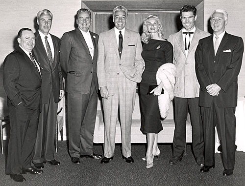 "1958 photo taken during the filming of the TV series ""26 Men"". (L-R) Irish McCalla's agent Shorty, Tris Coffin, series producer Russell Hayden, Cesar Romero, Irish (""Sheena"") McCalla, Kelo Henderson and ABC president George Shubert."
