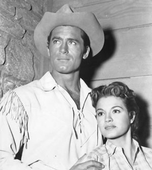 "Clint Walker and Angie Dickinson pose for the cameras while filming ""Cheyenne: War Party"" in '57."