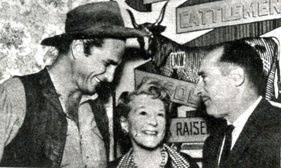 "Eric Fleming (""Rawhide"") chats with TV TIMES reporter Nora Laing and casting director Russel Trost. (Thanx to Terry Cutts.)"