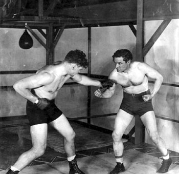 Sparring partners...World Heavyweight Champion from 1919-1926, Jack Dempsey, and Tom Mix. (Thanx to Bobby Copeland.)