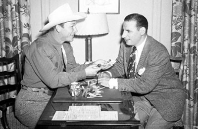Above two photos are of Roy Rogers with CHICAGO SUN-TIMES newspaper columnist Irv Kupcinet. Both circa late '40s early '50s. (Thanx to Bobby Copeland and Janey Miller.)