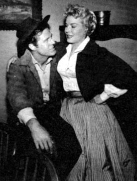 "Robert Culp, Hoby Gilman on ""Trackdown"", takes a break with leading lady Jeanne Willes."