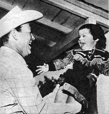 Roy Rogers in 1955 with 2 year old daughter Dodie.