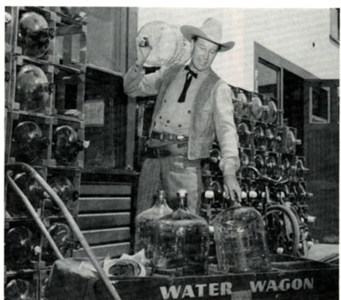 "Wild Bill Elliott loads bottles onto the Republic water wagon in this publicity shot taken for ""The Fabulous Texan"" in 1947."