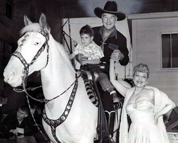 Hopalong Cassidy and a youngster fan poses with famous striptease artist Sally Rand at the Cotton Bowl in Dallas, TX, on 10/10/52. (Thanx to Bobby Copeland and Billy Holcomb.)