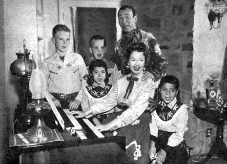 Roy rogers and dale evans and four of their children sing christmas