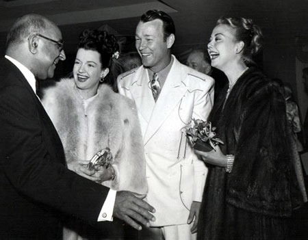 An unidentified man (Is that Republic Studio head Herbert J. Yates?) greets Dale Evans, Roy Rogers and Vera Ralston at a function in the mid to late '40s.