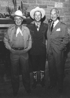 "Hoot Gibson, Roy and William Boyd at Roy's house. Taken during a rehearsal for the ""Western Hall of Fame Hoss Opera"" held at L.A.'s Olympic Auditorium 11/28/48."