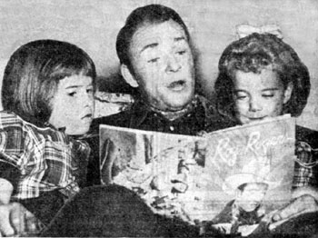 Roy entertains daughters Cheryl (left) and Linda Lou (right) by reading some of his comic book adventures from ROY ROGERS Dell #1 (1948).