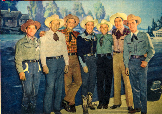 Roy Rogers with the Sons of the Pioneers (L-R) Shug Fisher, Karl Farr, Bob Nolan, Roy, Tim Spencer, Hugh Farr, Ken Carson.