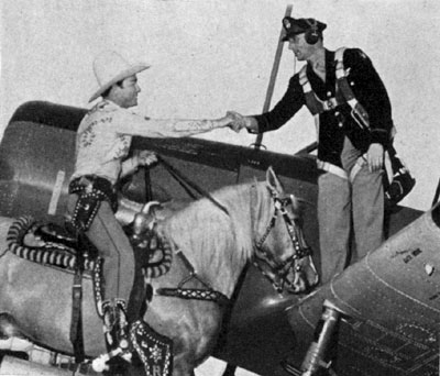 The King of the Cowboys meets the King of the Air, Col. John T. Sprague of the Waco Air Base in Waco, TX, during Roy's visit there to entertain service men in 1943.
