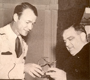 Roy presents a pair of silver spurs to Mayor Fiorello LaGuardia during a NY visit in 1943.