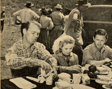 "Taking a lunch break while filming ""Branded"" in Arizona are (L-R) Alan Ladd, Mona Freeman and Peter Hansen."