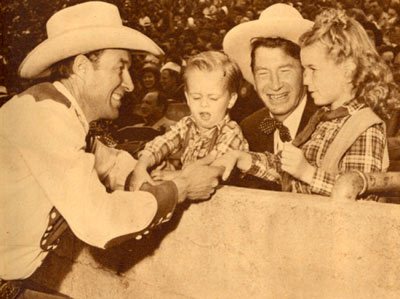 Chill Wills introduces his kids to Wild Bill Elliott at the July 1945 Roy Rogers Rodeo in Hollywood.