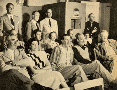 "During filming, daily rushes for Paramount's ""Branded"" were shown every night at the hotel. Seated in the front row are George J. Lewis (center) and Charles Bickford (R). Seated in the second row are Peter Hansen, Mona Freeman, Alan Ladd and Ladd's wife Sue Carroll. Standing at the far right is producer Mel Epstein."