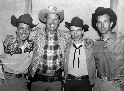"Wild Bill Elliott with western swing band Lucky Wray and the Lazy Pine Wranglers aka the Palomino Ranch Hands. (L-R) Link Wray, Doug Wray and Vernon ""Lucky"" Wray some time in the early '50s. After Vernon left the group, Link Wray went on to have a major career as a rock 'n&tsquo; roll guitarist beginning with ""Rumble"" in '58. (Photo courtesy Bobby Copeland.)"