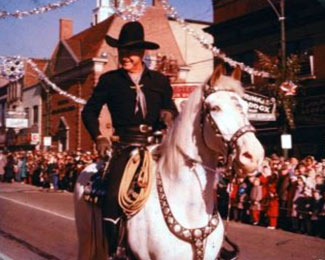 Hopalong Cassidy rides in a 1957 Christmas Parade in High Point, NC. (Thanx to Jerry Whittington.)