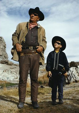 "John Wayne and son Ethan on the set of ""True Grit"" in 1969."