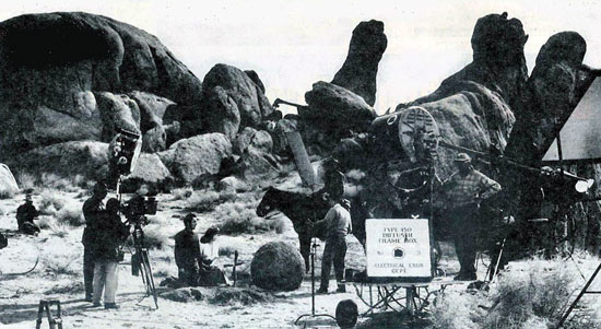"Tyrone Power and Susan Hayward wait as the 20th Century Fox crew sets up another shot for ""Rawhide"" ('51) in the Alabama Hills of Lone Pine, CA. (Thanx to Jerry Whittington.)"