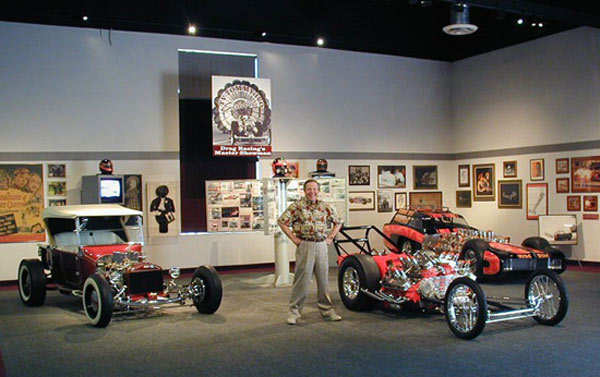 Cars of the Stars: TV Tommy Ivo, a member of the Drag Racing Hall of Fame, poses beside some of the dragsters he built in his garage at the NHRA Motorsports Museum in Florida. Ivo's incredible T-Bucket hot rod is on the left.