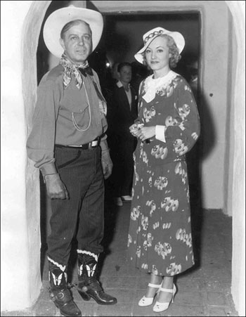 "Hoot Gibson and leading lady June Gale in 1935. The pair filmed ""Rainbow's End"" for Fist Division together and were romantically linked for a spell. June was one of four Gale sisters—June, Jane, Joan, Jean—who appeared in vaudeville, George White's Scandals and at the Palladium in London."
