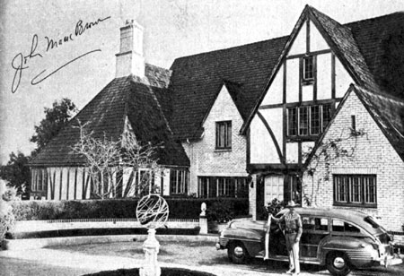 Cars of the Stars: Johnny Mack Brown in front of his 16 room English Colonial house in Beverly Hills in early 1946.