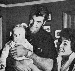 Rory Calhoun and wife Lita Baron regard parenthood as a great privilege. Here they practice with good friend Guy Madison's daughter Bridget in late '56.