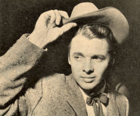 "Audie Murphy doffs his hat for fans at the premiere of ""Destry"" ('55)."