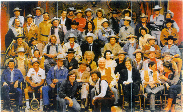 "A true Gathering of Guns: ""When the West was Fun"" aired on ABC TV in 1979. (Top row l-r) Rod Cameron, Jock Mahoney, Jack Kelly, Tony Young, John McIntire, Ty Hardin, Darby Hinton, Lee Van Cleef, Will Hutchins, Clayton Moore and Doug McClure. (2nd row l-r) X Brands, Bill Williams, Michael Ansara, Slim Pickens, Dick Jones, Don Diamond, Ken Curtis, John Russell, Terry Wilson, Peter Brown, James Drury. (3rd row l-r) Pat Buttram, Milburn Stone, Dan Haggerty, Guy Madison, Rex Allen, John Bromfield, Keenan Wynn, Jackie Coogan, George Montgomery. (4th row l-r) Denver Pyle, Iron Eyes Cody, Harry Lauter, Jeanette Nolan, Linda Cristal, John Ireland, Mark Slade, Joe Bowman, Fred Putnam. (Front row l-r) Dewy Martin, Johnny Crawford, Chuck Connors, Glenn Ford, Alan Hale Jr., Henry Darrow, Larry Storch and Neville Brand. The two producers of the special are kneeling in front."