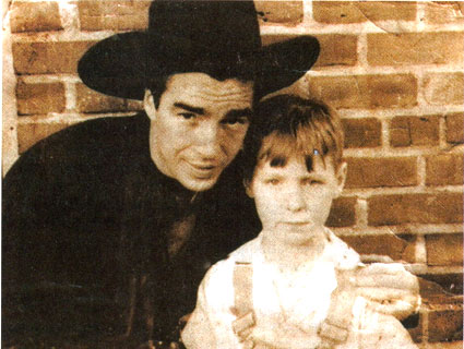Lash LaRue poses with a young fan following an appearance in South Carolina in the late '40s. (Thanx to Steve Jensen.)
