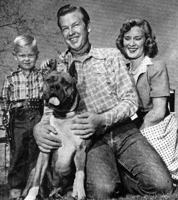 The Rex Allen family in August 1951. (L-R) Rex Allen Jr. aka Chico, Butch the Boxer, Rex and wife Bonnie. (Thanx to Jimmie Covington.)