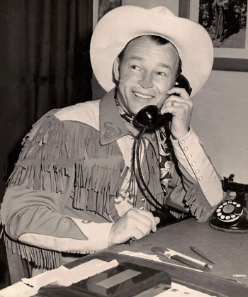 Roy Rogers conducts a little business on the phone. (Thanx to Jerry Whittington.)