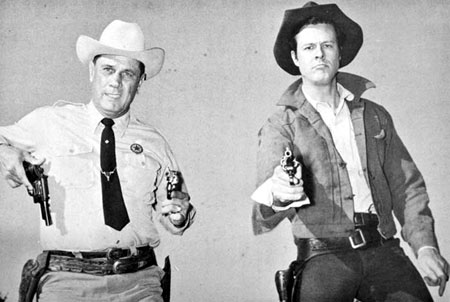 "Renowned Texas Ranger Jay Banks teaches Robert Culp how to ""thumb that hammer"" for Culp's role as Ranger Hoby Gilman on ""Trackdown"". Banks later became Chief of Police in Palestine, Texas."