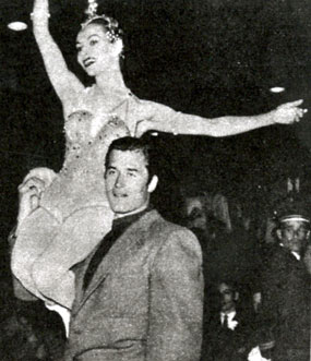 "Clint ""Cheyenne"" Walker easily lifts a skating starlet at a late '50s Icecapade show. (Thanx to Terry Cutts.)"
