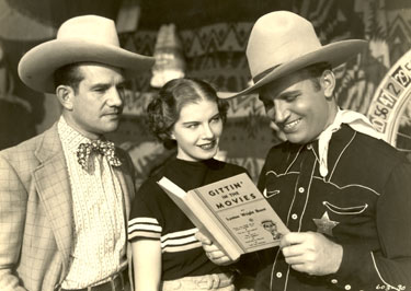 "Already a star by 1936 when Gene Autry was making ""The Old Corral"", he gets a chuckle out of the book GITTIN' IN THE MOVIES while his leading lady Hope Manning and Cornelius Keefe look on."