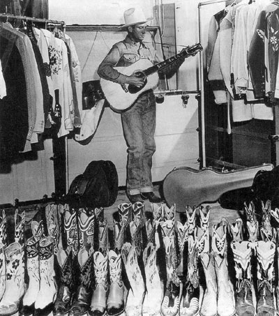 Gene Autry in his clothes closet. (Thanx to Jerry Whittington.)