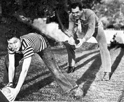 In March 1946, Johnny Mack Brown shows his 12 year old son Lachlan some of the moves that made Johnny famous in the Rose Bowl game of 1925.