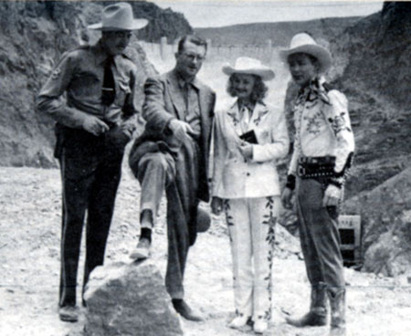 "At Boulder Dam, director Frank McDonald (second from left) explains the next scene in Republic's ""Heldorado"" ('46) to LeRoy Mason, Dale Evans and Roy Rogers."