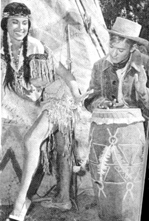 "Will ""Sugarfoot"" Hutchins beats a few hot licks on a war drum while Lisa Montell chants from ""The Indian Love Song""."
