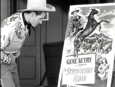 "In ""Hoedown"" ('50 Columbia) Jocko Mahoney plays brokendown, naive ex-cowboy star Stoney Rhodes. This cute scene in the movie comes when Jocko talks to a Gene Autry one-sheet in front of a theater. (Thanx to Jimmy Glover.)"
