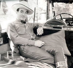 Tom Mix seems very relaxed in one of his automobiles, circa late '30s?