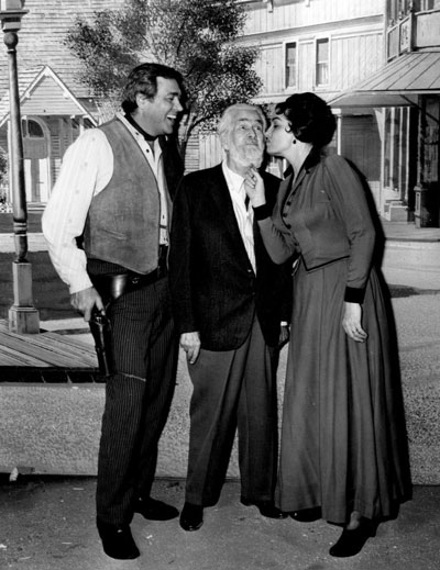"Howard Keel and Jane Russell were filming ""Waco"" in '66 for A. C. Lyles on the backlot of Paramount when Gabby Hayes stopped by for a kiss from Jane. (Thanx to Bobby Copeland.)"