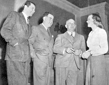"James Ellison, Republic President Moe Siegel, Herbert J. Yates, Republic Chairman of the Board and Virginia Gilmore on the set of ""Mr. District Attorney in the Carter Case"" ('41)."