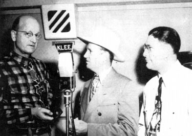 In April 1948, Gene Autry received his official receipt as a Houston Aerie member in the Fraternal Order of Eagles. With Gene are Eagle W. Albert Lee, KLEE radio station owner, and Jake Colca, Eagle Grand Outside Guard.