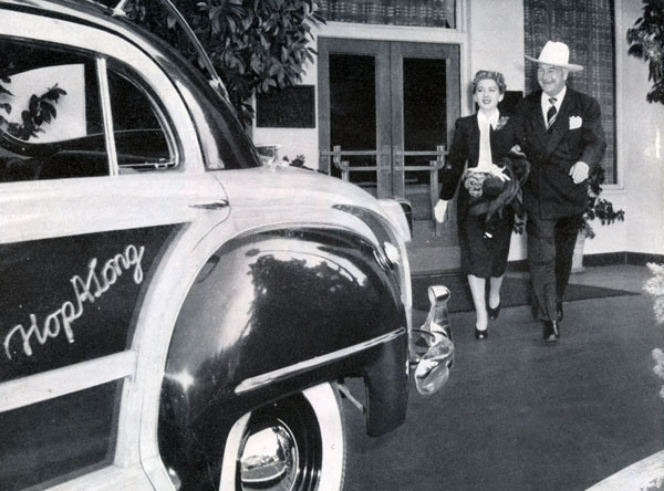 Grace Bradley and Bill Boyd head for the Hopalong station wagon in 1947.