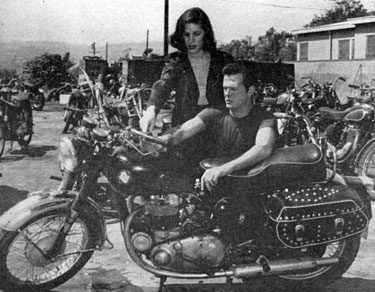 "Robert Culp, star of TV's ""Trackdown"", and wife Nancy, whom Bob courted on this motorcycle."