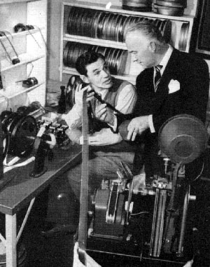 Hopalong Cassidy (William Boyd) consults with film editor Fred Berger in 1947.
