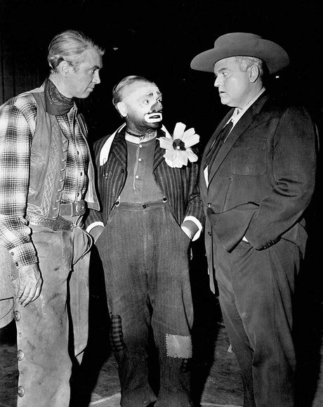 "Three giants of the movie industry take a break while making their respective films in 1956. James Stewart was starring in ""Night Passage""; James Cagney was making ""Man of 1,000 Faces"" and Orson Welles was making ""Man in the Shadow"". (Thanx to Pat Shields.)"