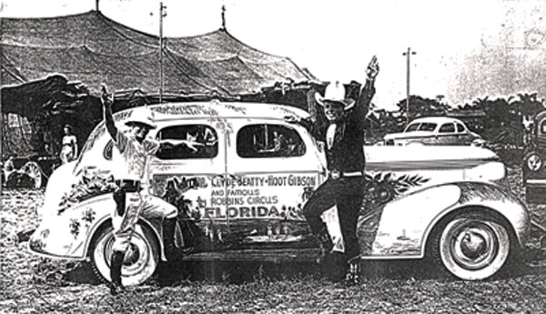 Clyde Beatty and Hoot Gibson beside a 1937 Studebaker in Jacksonville, FL, in October 1938 getting ready for the Robbins Circus tour.